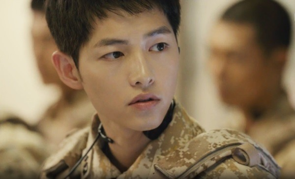 "Song Joong Ki as Captain ""Big Boss"" Yoo Shi Jin, Descendants of the Sun"